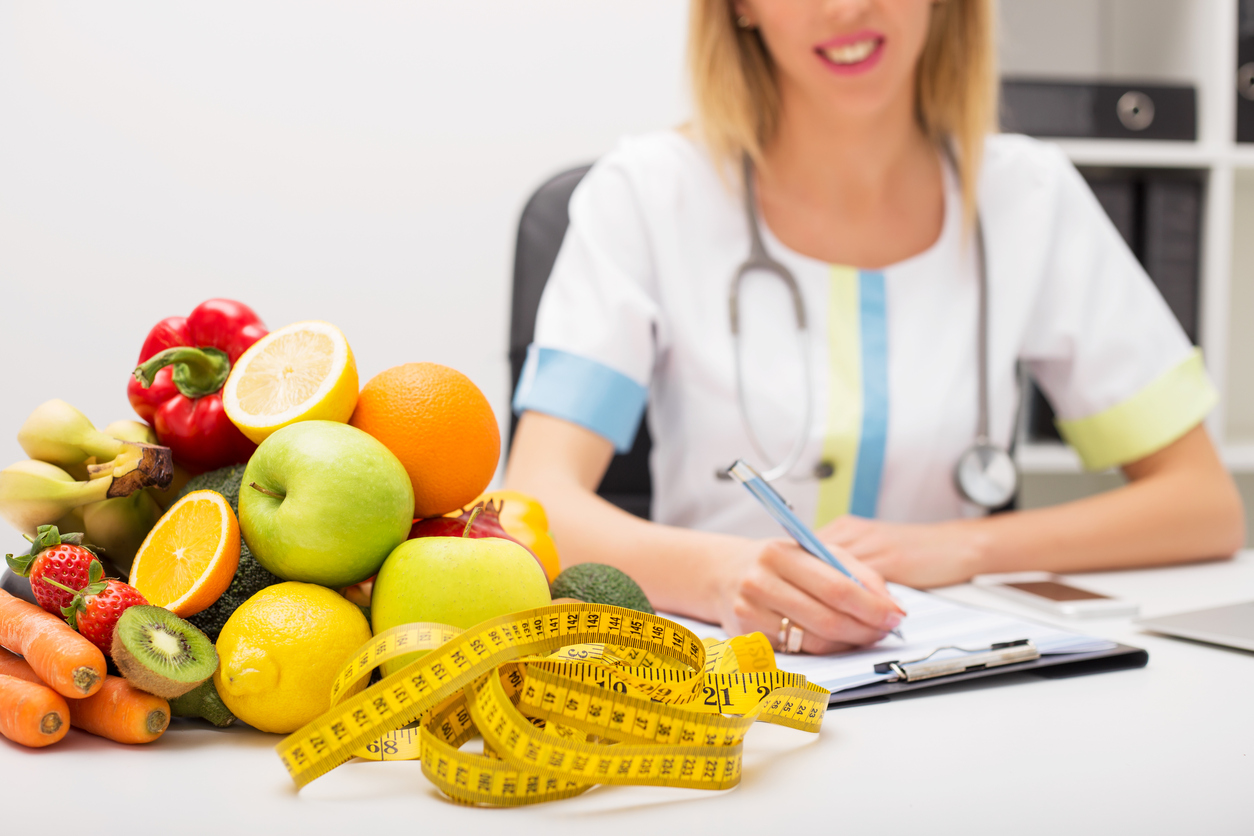 Tape measure and vegetables on doctors table